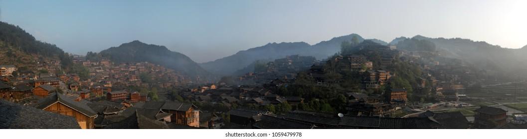 Panoramic view of Xijiang Qianhu Miao Village in Guizhou, China at sunrise