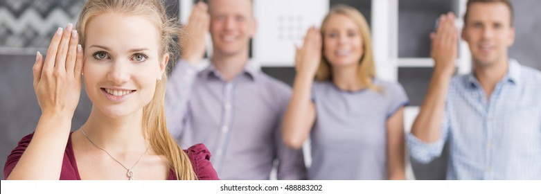 """Panoramic view of a young woman showing the word """"to welcome"""" using sign language"""