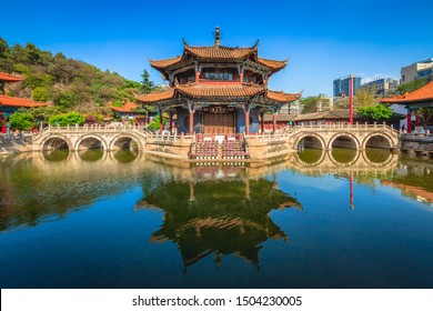 Panoramic view of Yuantong Temple, ancient Buddhist temple in Kunming Yunnan China, structure of a Buddhist hall surrounded by water and main hall maintains the style of the Yuan Dynasty architecture.
