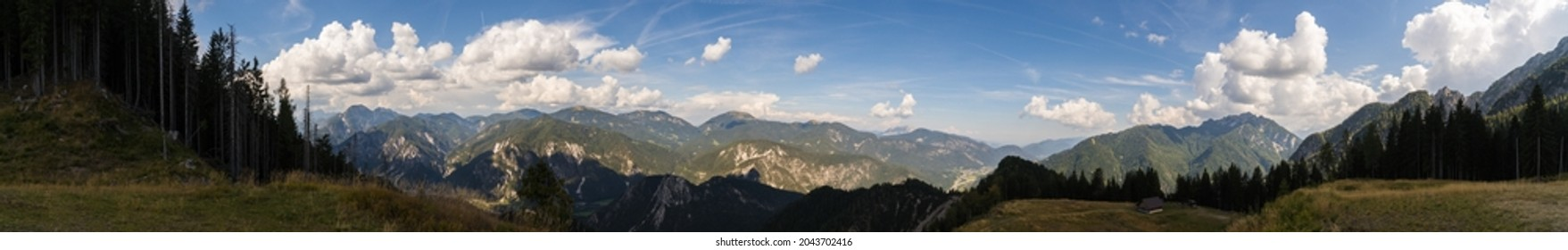 A panoramic view from the Zita Chapel nerby Valbruna over the Julian Alps, stretching along Monte Cocco, Oisternig, Monte Lussari and Cima del Cacciatore