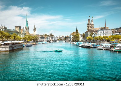 Panoramic view of Zurich city center with churches and boats on beautiful river Limmat in summer, Canton of Zurich, Switzerland
