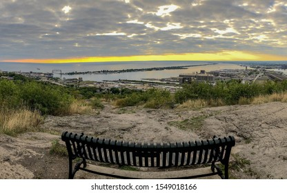 Panoramic viewpoint from a park bench at Enger Park overlooking Duluth harbor