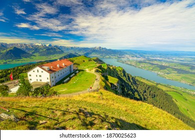 Panoramic views along trail around Rigi Kulm, the highest peak on Mount Rigi over 13 lakes and peaks of Swiss Alps. Canton of Lucerne, Central Switzerland. Green meadows, outdoor activities in summer.