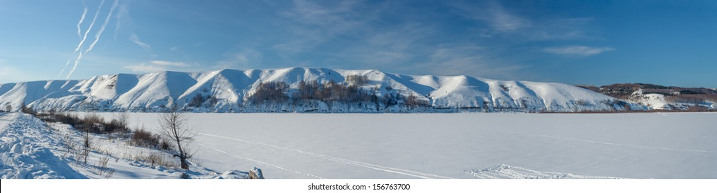 Panoramic views of the beautiful hilly bank of the river in winter. Russia, Tatarstan, the Kama River, Lower Kama region.