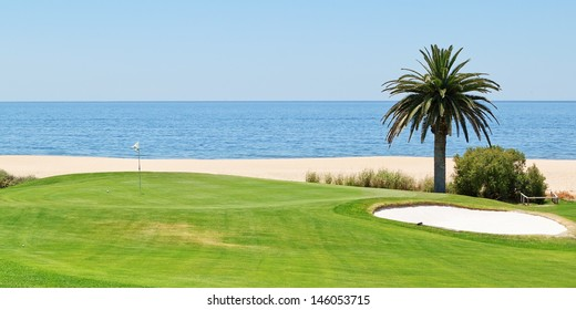 Panoramic views of the golf course to the sea and palm trees. Portugal, Algarve.