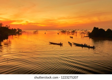 Panoramic views of Thale noi water park and scenic viewpoint in the morning. it landmark for tourists to see the large fisherman's tools at Thale noi, Phatthalung, Thailand. silhouette.