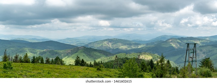 Panoramic views from top of Velka Raca peak in Kysucke Beskydy mountains in northern Slovakia near small village of Oscadnica
