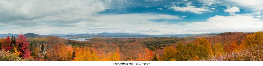 Panoramic vista of Western Maine New England in the fall with colorful foliage, lakes and hills