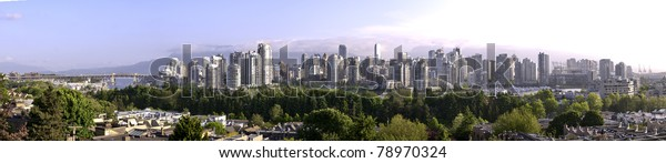 Panoramic water view of Vancouver from false creek. There is a light early morning mist.The roof is being built on B.C.Place.