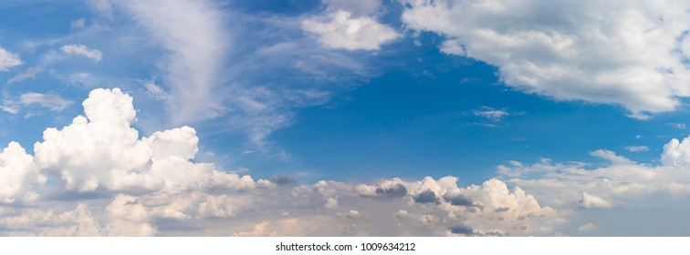 Panoramic white fluffy clouds in the blue sky, Fantastic soft white clouds against blue sky