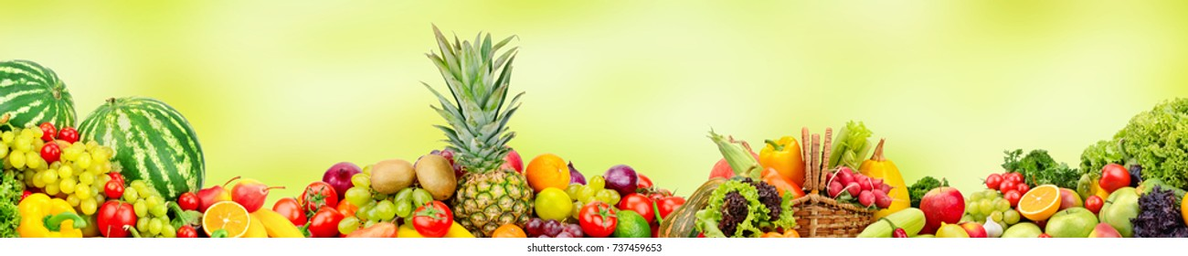 Panoramic wide collection fruits and vegetables for skinali on blur green background