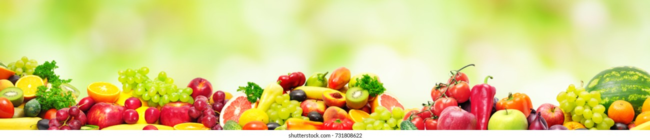 Panoramic wide photo healthy and useful vegetables and fruits isolated on white background. Assortment fresh products - apples, bananas, watermelon, grapes, pears, carrots, citrus. Copy space
