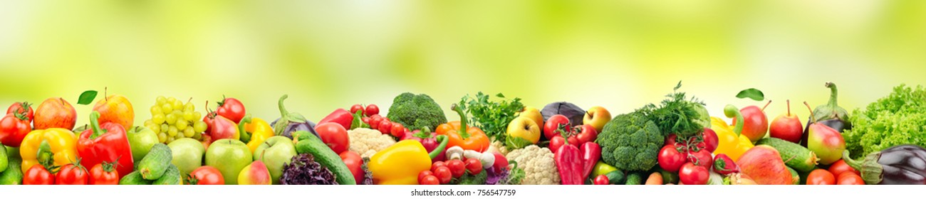 Panoramic wide photo healthy and useful vegetables and fruits isolated on white background. Assortment fresh products - apples, bananas, grapes, pears, carrots, citrus. Copy space