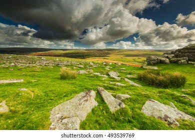 Panoramic wide view from Dartmoor Tor, dramatic sky and autumn colors