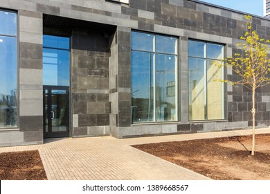 Panoramic window of modern residential building view outside. Insulating glass (glazing, pane). Storm windows. Ground floor apartment. first for shops, offices and commercial premises. Rainscreen