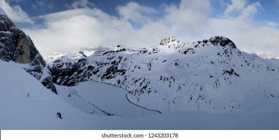 Panoramic winter view of Alpine mountains. Sella Ronda. Marmolada. Dolomites. South Tirol. Italy.