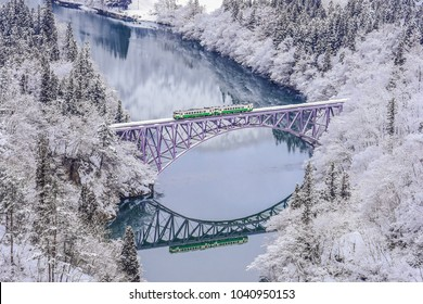 Panoramic Winter View of Tadami Railway Line And Bridge Reflection in The Valley of Tadami River, Mishima Machi, Aizu, Fukushima, Japan