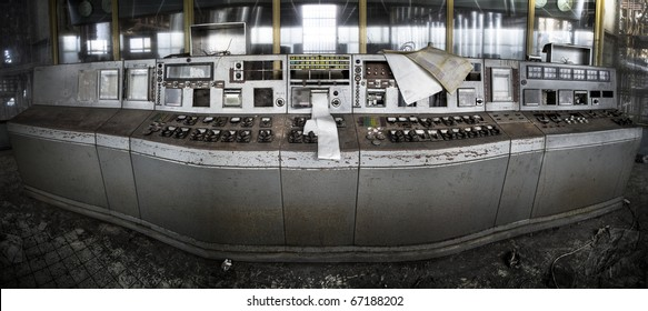 A panoramis picture of an abandoned controle room