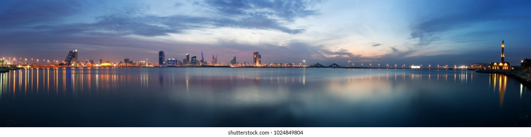 Panormic view of Bahrain skyline with reflection after sunset
