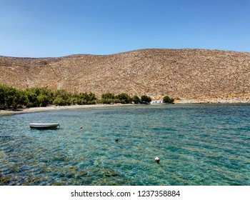 Panormos beach in Tinos island in Greece in a sunny day with blue sky. HDR effect.