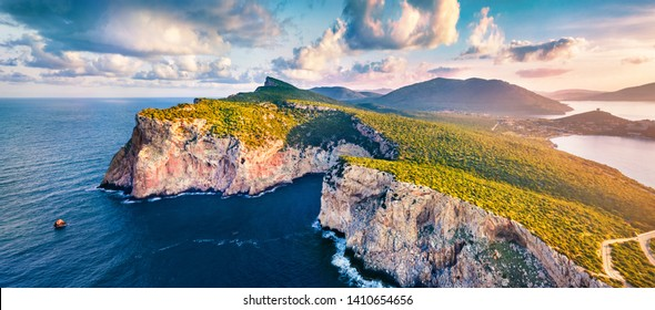Panotamic view from flying drone. Great sunrise on Caccia cape. Breathtaking spring scene of Sardinia island, Italy, Europe. Fantastic morning seascape of Mediterranean sea.