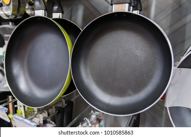 Pans hang on shelf in the store.