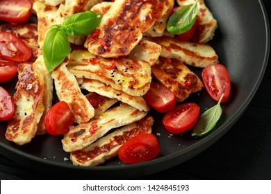 Pan-seared halloumi cheese and sweet cherry tomatoes salad