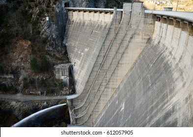 Panta de Cavallers is a concrete slender arch dam in the Spanish Pyrenees. It supports a power station. The dam creates a water reservoir Embassament de Cavallers upper the Boi valley.