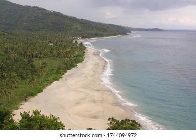 Pantai Setangi with nobody on the beach, near Senggigi, Lombok, Indonesia. Exotic tropical destination beach on island