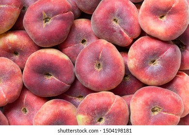 Pan-tao peach background with closeup on many market fresh peaches.