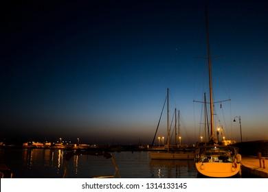 pantelleria island marina at night with sailboats