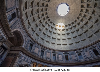 Pantheon's coffered Dome in Rome, Italy-March 28, 2018: Former Roman temple, completed by emperor Hadrian, best-preserved ancient roman building, now a Catholic church dedicated to St. Mary, Italy