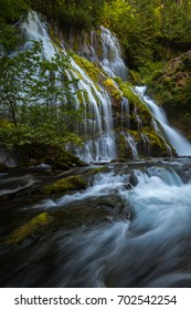 Panther Creek Falls flowing during the late summer months glowing in the sunlight.