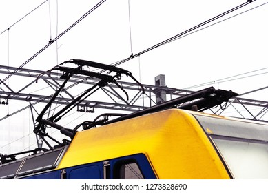"""A pantograph (or """"pan"""") is an apparatus mounted on the roof of an electric train, tram or electric bus to collect power through contact with an overhead line."""
