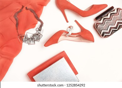 Panton color of the year 2019 - Living Coral. female stylish accessories fashion luxury outfit set: cloth, shoes jewelry. Christmas New Year Valentine's day Party conception. Flat lay, toned, red
