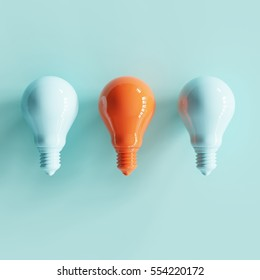 pantone pastel light bulbs with contrast colos on white background. minimal concept. top view.
