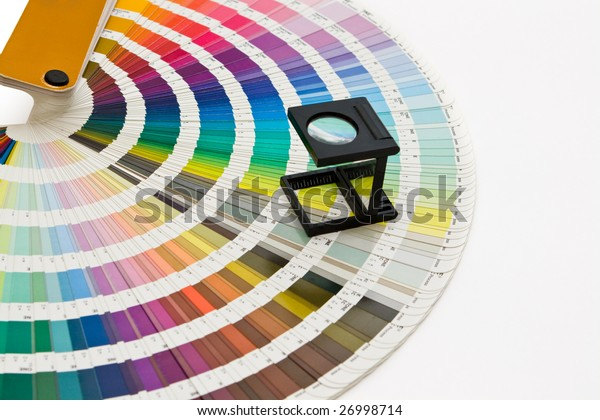 Pantone swatch and magnifying glass
