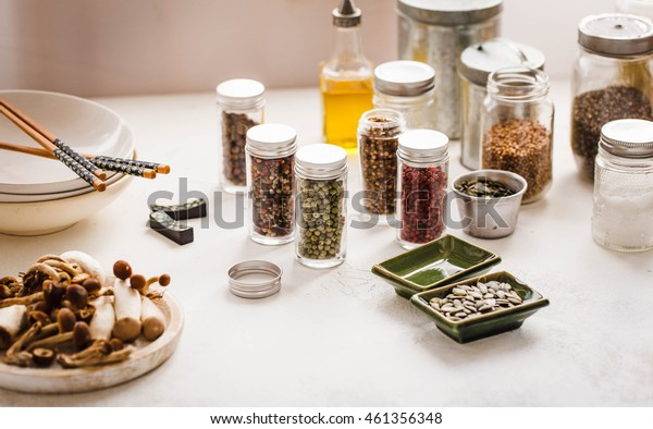 Pantry full of different spices and condiments in glass jars.