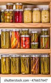 Pantry shelves loaded with jars of pickled vegetables