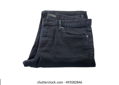 Pants made of cotton. Folded Jeans trousers in black, natural fabric cloths isolated on white background