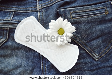 panty liners and tampons on jeans background