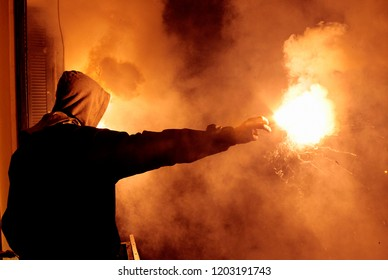 PAOK football club fan holds a torch during a protest rally against the new sports law reform from Greek goverment in Thessaloniki, Greece on Mar 12, 2012
