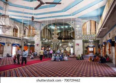 PAONTA SAHIB, INDIA - MARCH 22, 2017: Sikh believers are worshipping inside the Sikh temple at Paonta Sahib, india, a Sikh pilgrimage destination.