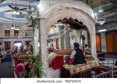 PAONTA SAHIB, INDIA - MARCH 22, 2017: A Sikh priest sits inside the Sikh temple at Paonta Sahib, a Sikh pilgrimage destination.