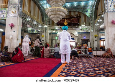 PAONTA SAHIB, INDIA - MARCH 22, 2017: Sikh believers are worshipping inside the Sikh temple at Paonta Sahib,india, a Sikh pilgrimage destination.