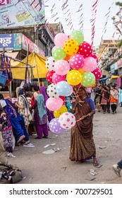 PAONTA SAHIB, INDIA - MARCH 22, 2017: A woman selling colorful balloons on a fair at Paonta Sahib, India, a Sikh pilgrimage destination.