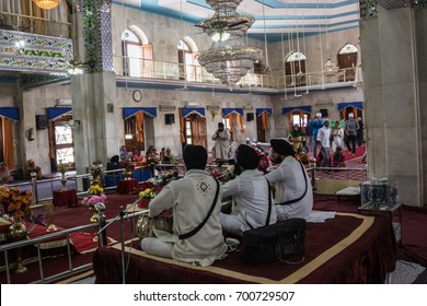 PAONTA SAHIB, INDIA - MARCH 22, 2017: Sikh musicians are playing inside the Sikh temple at Paonta Sahib,india, a Sikh pilgrimage destination.