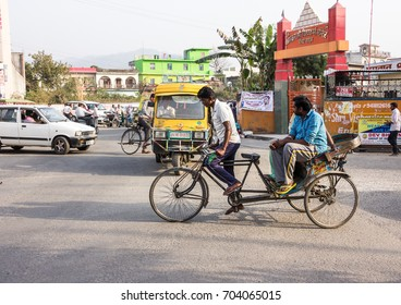 PAONTA SAHIB, INDIA - MARCH 23, 2017: A man powered rikshaw at Paonta Sahib, India. This type of vehicle is slowly disappearing of the indian streets.