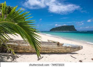 Paopao - traditional Samoan wooden timber kayak on the white sand of Lalomanu Beach, Upolu Island, Samoa, South Pacific