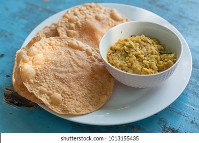 Papadum bread and vegetarian dal from lentils or beans. Food popular in Nepalese, Pakistani, Sri Lankan, Indian and Bangladeshi cuisines.